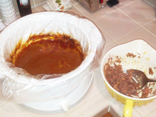The sauce in the crockpot after most of the meat has been removed and spooned into the burritos.