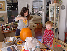 Heidi and Hunter cleaning the pumpkin.