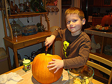 Hunter cleaning out a pumpkin