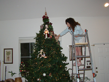 Heidi decorating the tree.